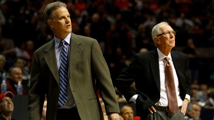 San Diego State assistant head coach Brian Dutcher looks on with head coach Steve Fisher during a ga