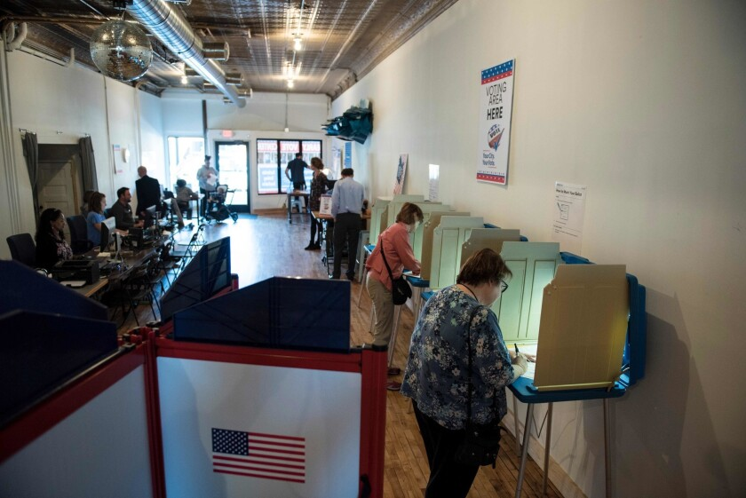 Balloting takes place at an early voting center in Minneapolis last week.