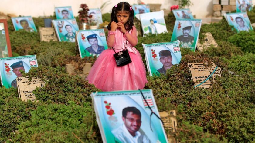 A Yemeni girl stands near the graves of relatives in a cemetery in the capital Sana'a on Friday.