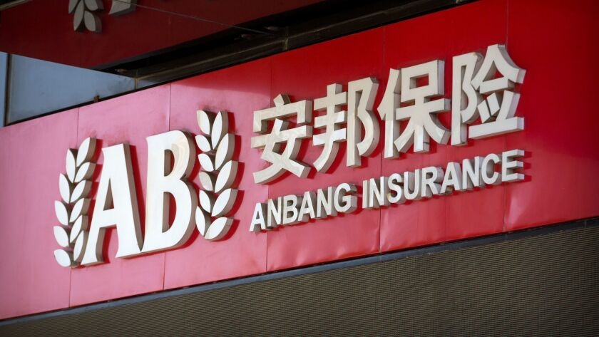 The logo of the Anbang Insurance Group is seen on the company's offices in Beijing, Wednesday, June