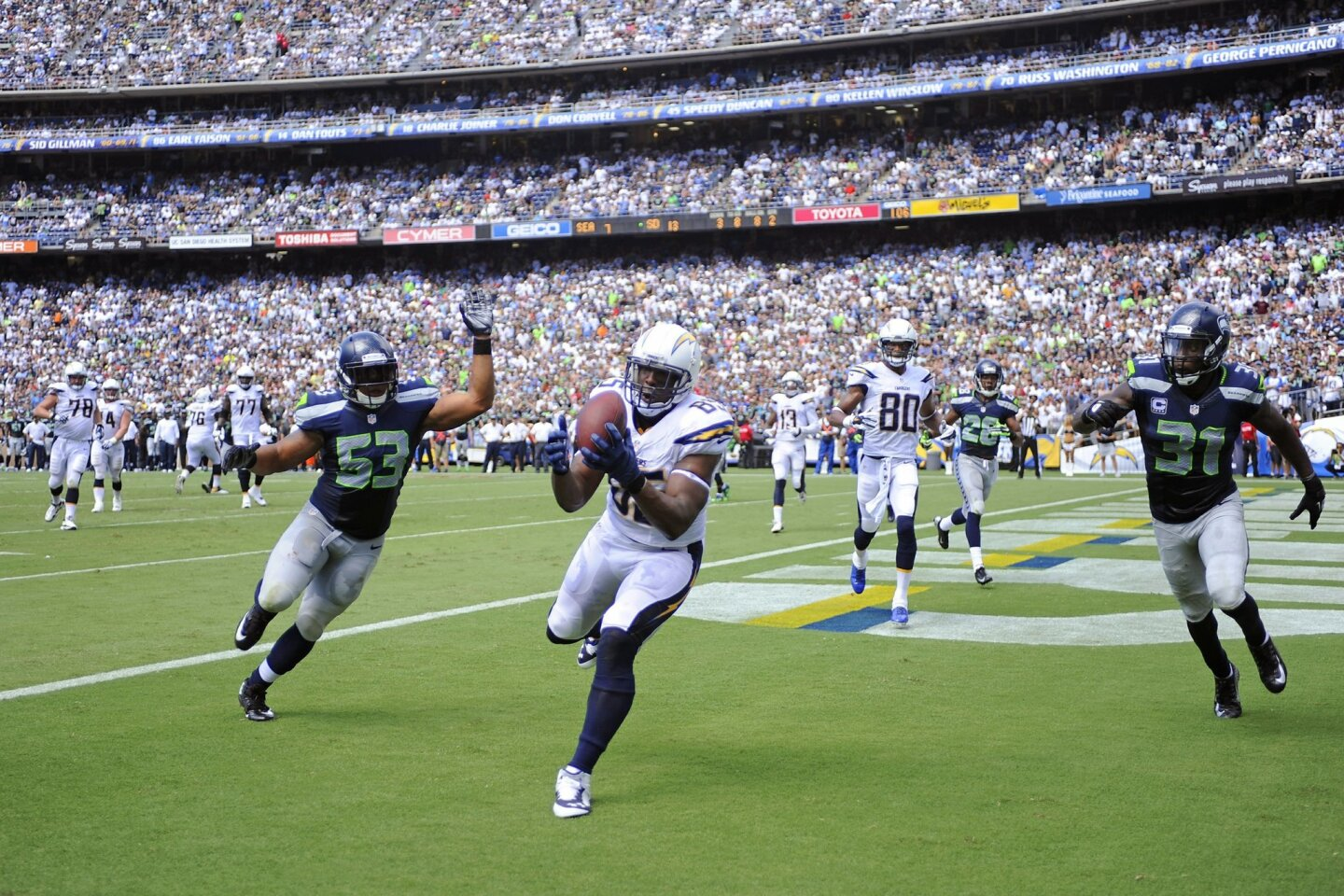 Chargers Antonio Gates catches a touchdown past Seattle's Malcolm Smith in the 2nd quarter.