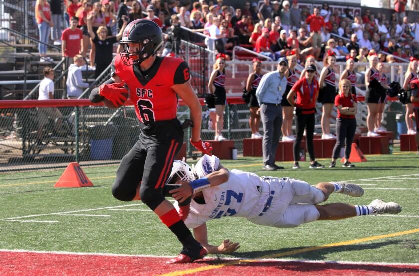 Santa Fe Christian's Cade Ellis runs a touchdown. Defending for La Jolla County Day is Zach Alligood.