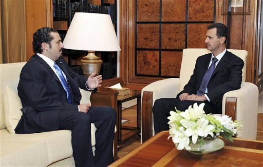 In this photo released by the Syrian official news agency SANA, and taken Sunday, Aug. 29, 2010, Syrian President Bashar Assad, right, meets with Lebanese Prime Minister Saad Hariri, in Damascus, Syria. Assad urged the Lebanese prime minister to support the militant group Hezbollah and maintain calm in Lebanon. (AP Photo/SANA)