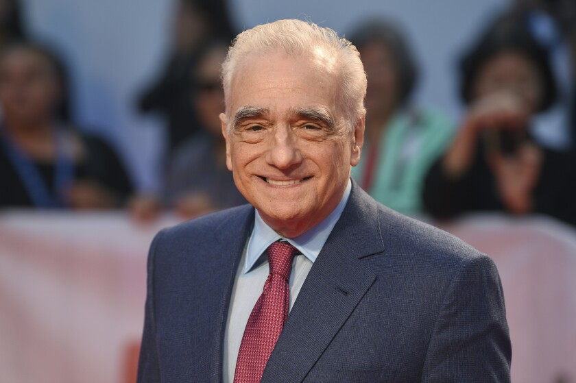"FILE - In this Sept. 5, 2019 file photo, Martin Scorsese attends the premiere for ""Once Were Brothers: Robbie Robertson and The Band"" on day one of the Toronto International Film Festival at the Roy Thomson Hall in Toronto. Scorsese's crime epic ""The Irishman"" is set to make its premiere at the New York Film Festival. The director's 209-minute opus, starring Robert De Niro, Al Pacino and Joe Pesci, is among the most anticipated films of the year. It will play first for members of the press Friday, Sept. 27, and then have its red-carpet premiere in the evening.(Photo by Evan Agostini/Invision/AP, File)"