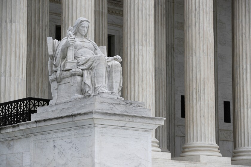 The Contemplation of Justice statue stands outside the Supreme Court on Capitol Hill in Washington, Monday, July 6, 2020. (AP Photo/Patrick Semansky)