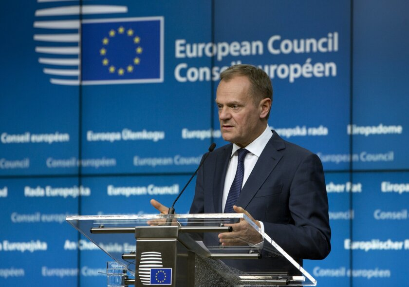 European Council President Donald Tusk speaks during a media conference at an EU summit in Brussels on Friday, Feb. 19, 2016. European Union leaders are holding a summit in Brussels on Thursday and Friday to hammer out a deal designed to keep Britain in the 28-nation bloc. (AP Photo/Virginia Mayo)