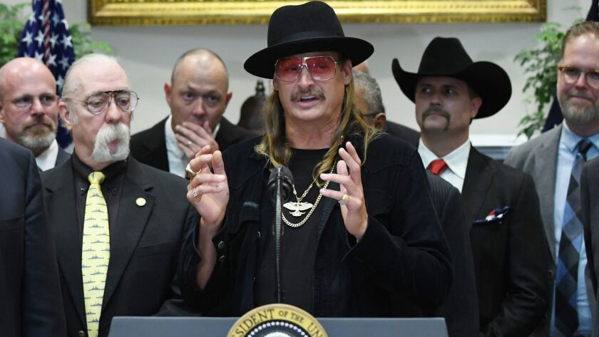 Musician Kid Rock speaks before President Trump signs the Music Modernization Act into law in the Roosevelt Room of the White House on Thursday.