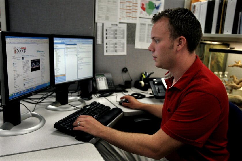 Daniel Sundin monitors and passes along information via Twitter, blogs and Petco Animal Supplies' Facebook page from his office at Petco's headquarters in Sorrento Mesa.