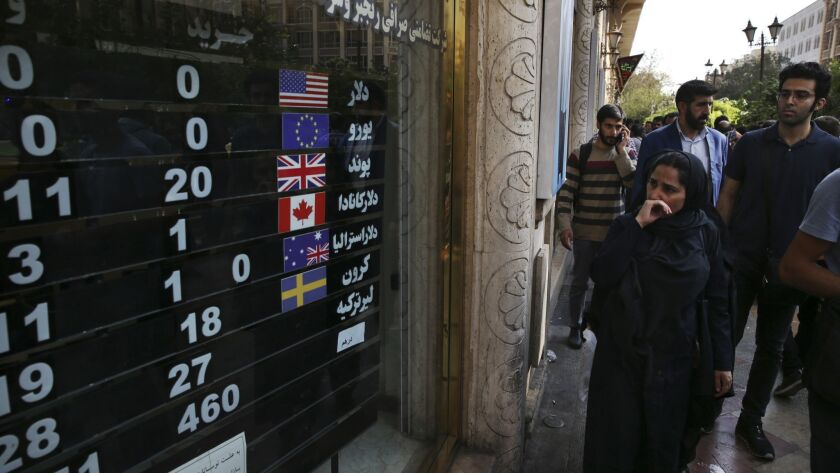 FILE - In this Oct. 2, 2018 file photo, an exchange shop displays rates for various currencies, in d