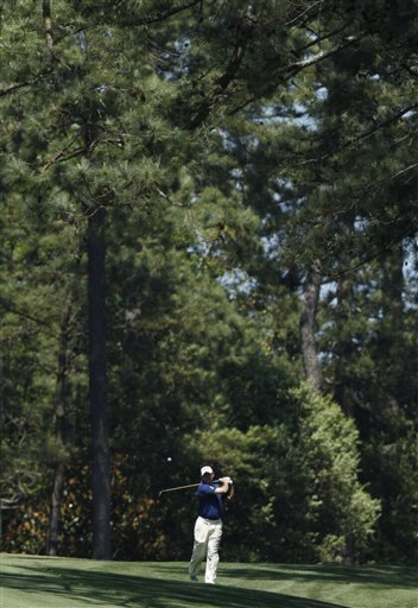 Lee Westwood of England hits off the second fairway during a practice round for the Masters golf tournament Monday, April 4, 2011, in Augusta, Ga. (AP Photo/Matt Slocum)