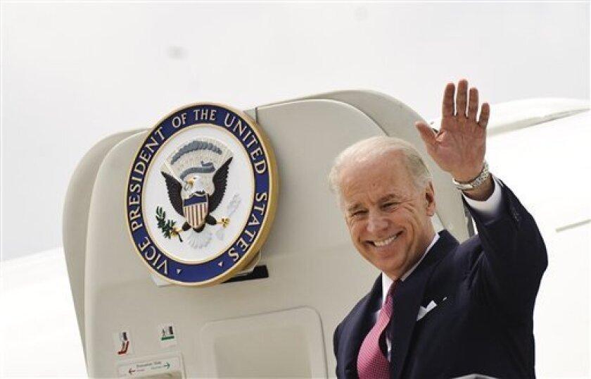 U.S. Vice President Joe Biden Biden waves as he walks down the stairs on his arrival at Torrejon de Ardoz Militar Base, near Madrid, Friday, May 7, 2010.(AP Photo/Daniel Ochoa de Olza)