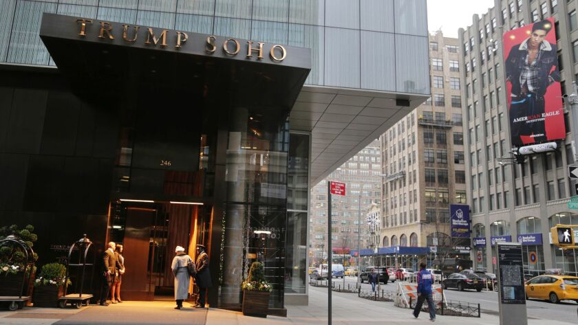 The Lakers won't stay at the Trump Soho hotel as originally planned this week.