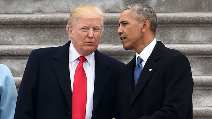 Presidents Trump and Obama talk at the former's inauguration ceremony on Jan. 20, 2017.
