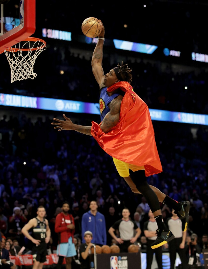 Dwight Howard soars to the rim for a dunk in his modified Superman outfit.