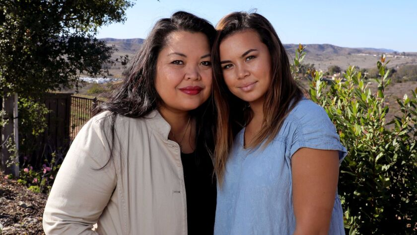 Portrait of Celine Showman, 42, left, with her daughter Megan Showman, 17, at the Oceanside home of Celine's aunt. Celine will ride on the American Heart Association float in the Rose Parade. Megan