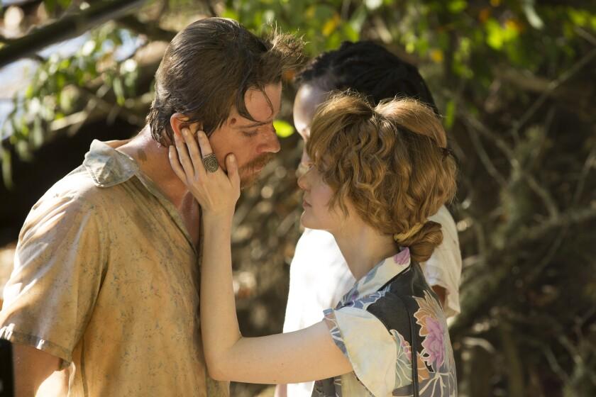 Garrett Hedlund and Andrea Riseborough in the movie 'Burden'