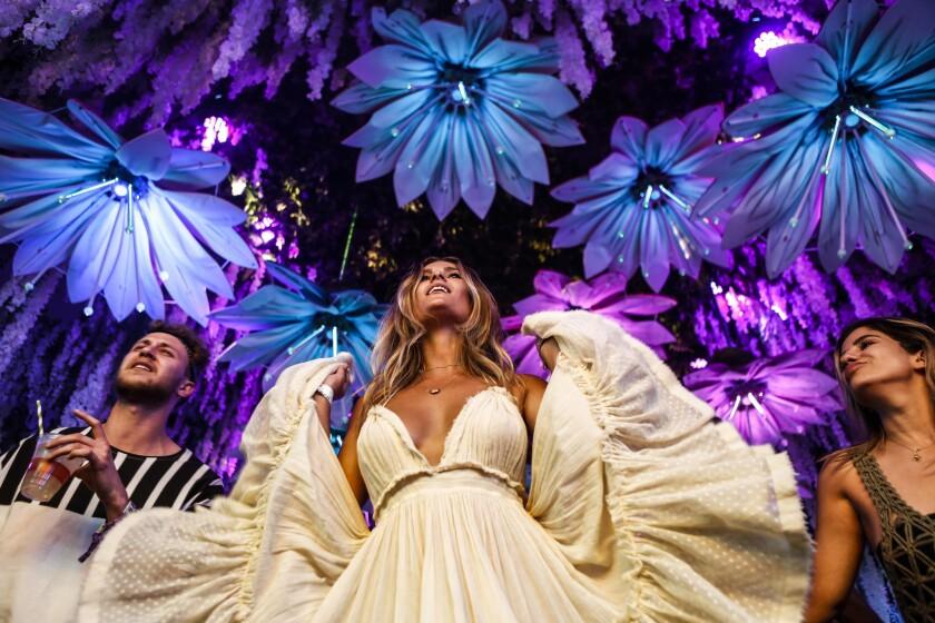 Australian native Chole Chapman, center, dances inside the HP tent during Coachella week two.