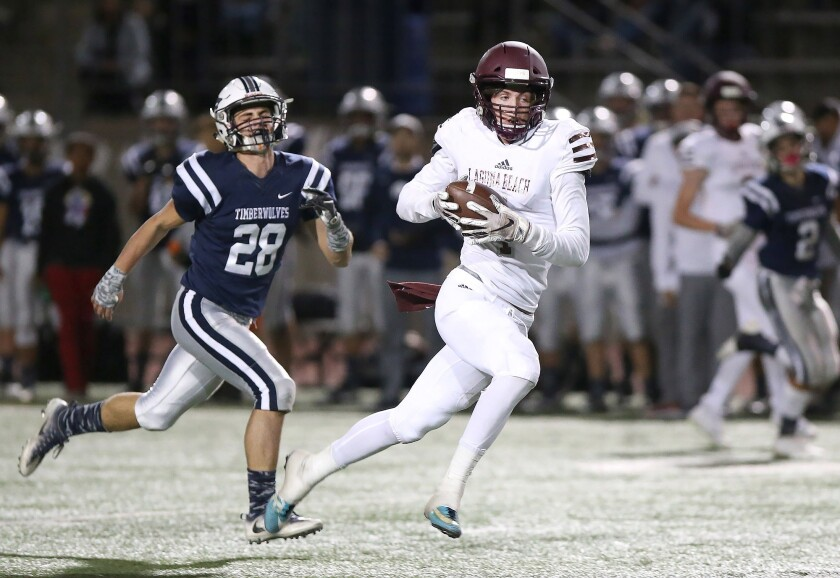 Sean Nolan pulls in a pass on the run and takes it to the end zone in Laguna Beach High's CIF Southern Section Division 12 quarterfinal playoff game against Northwood at Irvine High on Nov. 9, 2018.
