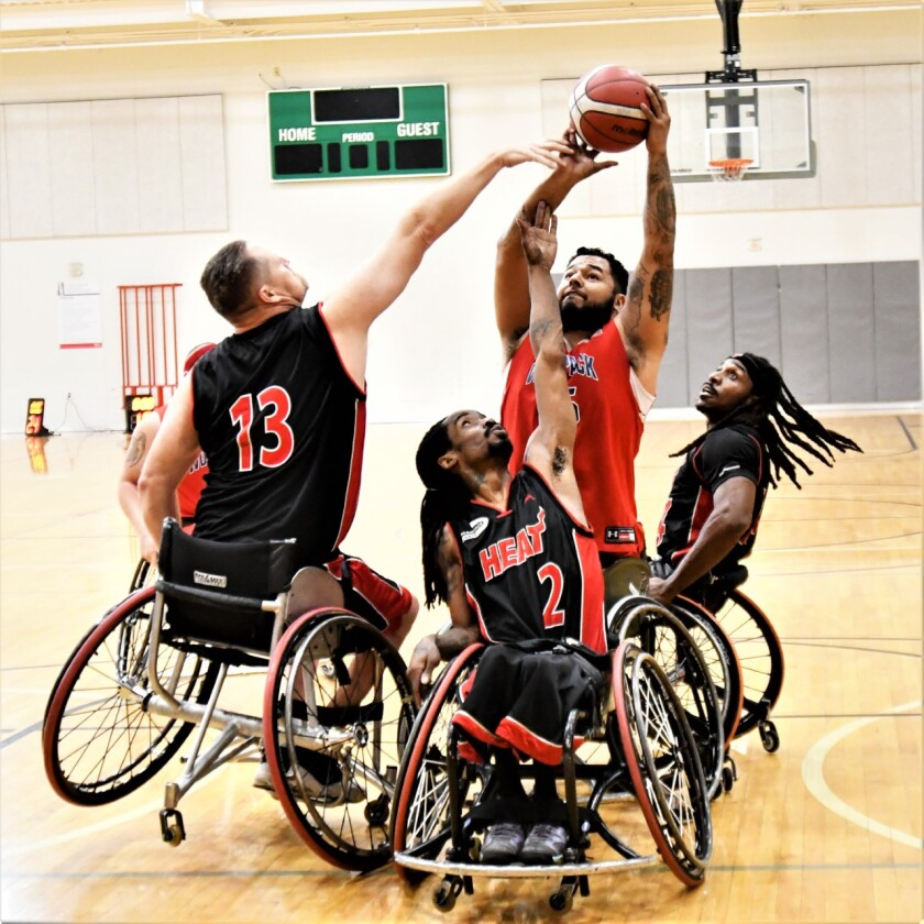 Retired U.S. Marine Jorge Salazar, a member of the San Diego Wolfpack, takes a shot while playing against the Miami Heat at the annual Capital Wheelchair Basketball Invitational, Fort Washington, Md.