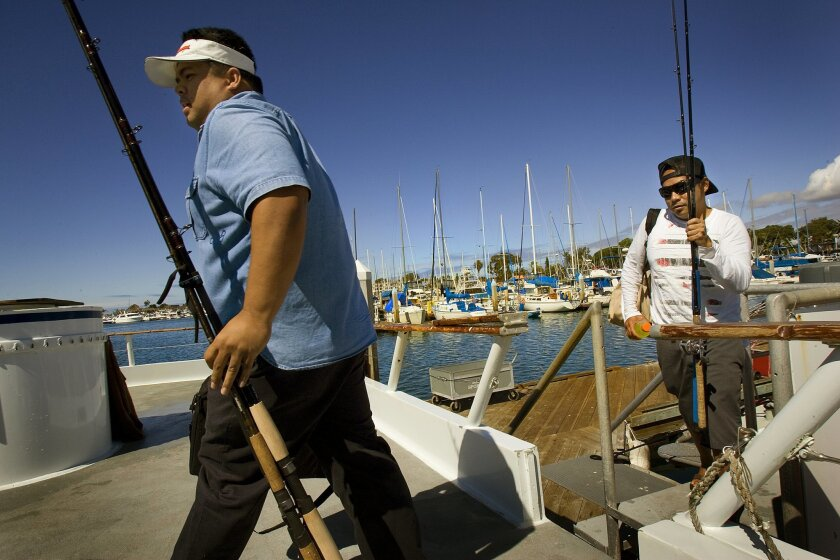 At Seaforth Sportfishing in Mission Bay, Ray Balinghasay (left) and Richard Clamor boarded the Dolphin last week for a recreational fishing excursion off La Jolla. (Nelvin C. Cepeda / Union-Tribune)