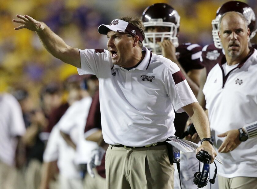 FILE - In this Sept. 20, 2014, file photo, Mississippi State head coach Dan Mullen calls out from the sideline in the second half of an NCAA college football game against LSU in Baton Rouge, La. No. 3 Mississippi State has its highest ranking ever and now hosts possibly the biggest game in school history when No. 2 Auburn comes to town on Saturday, Oct. 11, 2014. (AP Photo/Gerald Herbert, File)