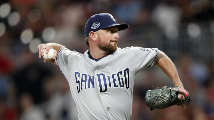 Padres closer Kirby Yates pitches against the Atlanta Braves on April 30, earning one of his MLB-leading 19 saves.