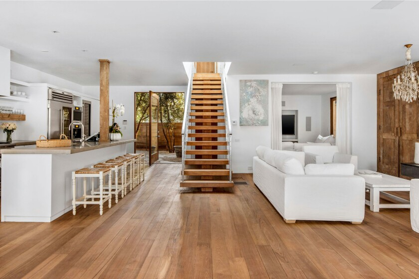 Overlooking Malibu Lagoon, the mini compound holds a 5,500-square-foot main house, one-bedroom guesthouse and sun deck with a swimming pool.