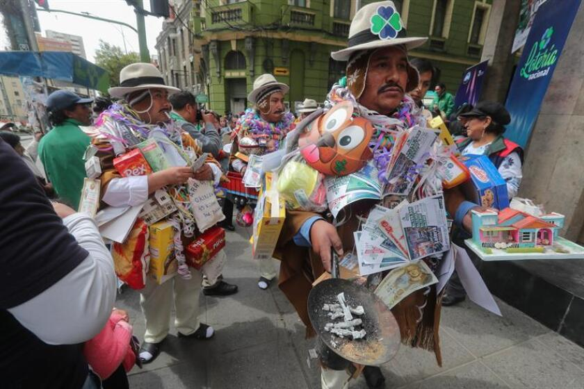 Almost a dozen persons dressed up as Ekeko in La paz, Bolivia, on Jan. 16, 2018 to promote the miniature fortune tickets, which sells for a little more than $1, as Bolivians' best chance for winning the mini-lottery. EPA-EFE/Martin Alipaz