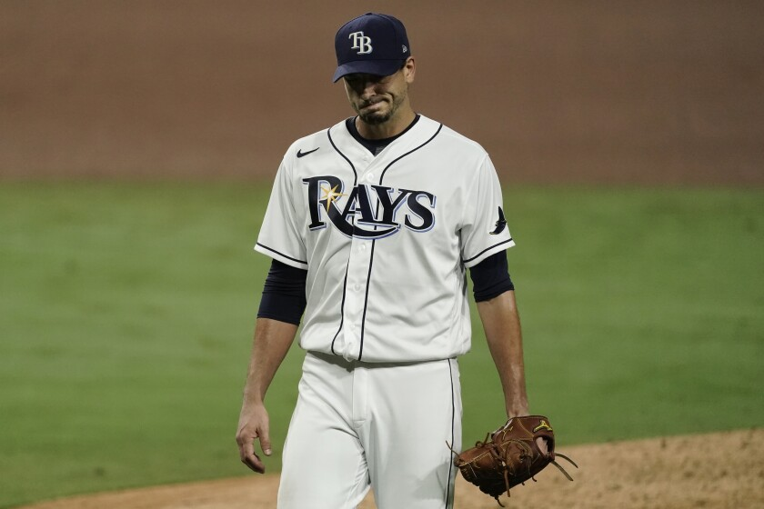 Tampa Bay Rays starting pitcher Charlie Morton walks off the mound after being relieved during the sixth inning in Game 7 of a baseball American League Championship Series against the Houston Astros, Saturday, Oct. 17, 2020, in San Diego. (AP Photo/Ashley Landis)