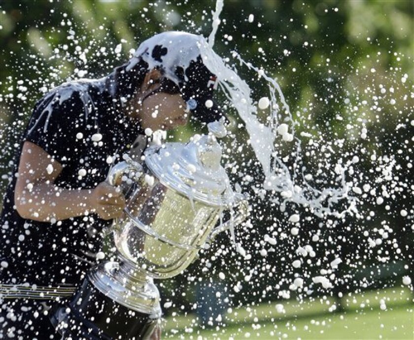 Eun Hee Ji, of South Korea, is doused with champagne after winning the U.S. Women's Open golf tournament, Sunday, July 12, 2009, at Saucon Valley Country Club in Bethlehem, Pa. (AP Photo/Mel Evans)