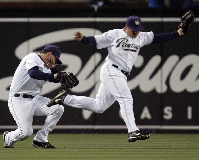 Padres center fielder Jim Edmonds, left, and left fielder Paul McAnulty nearly collide while going for a short fly ball hit to shallow center by Ray Durham. McAnulty came away with the catch to end the top of the fourth inning. Sean M. Haffey/Union-Tribune