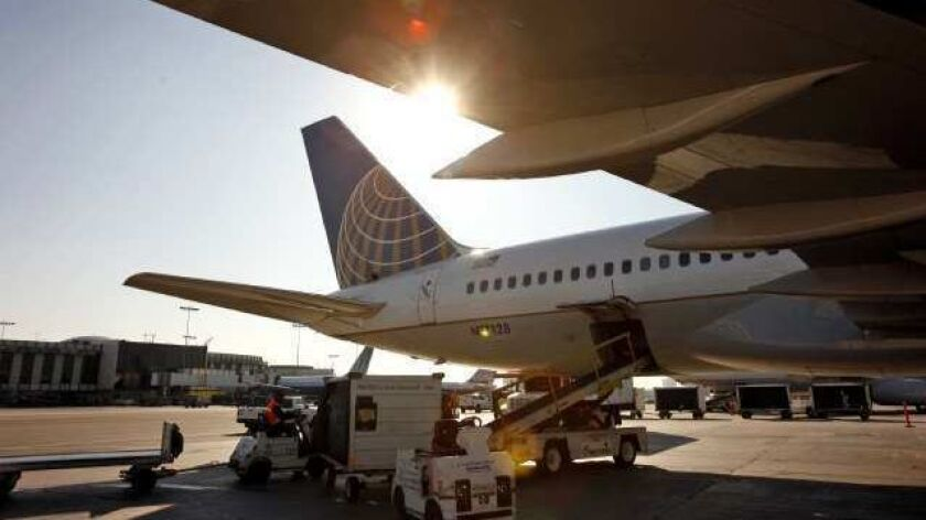 LOS ANGELES, CA NOVEMBER 22, 2011 -- Aircraft and airplanes of United Airlines and Continental Airl