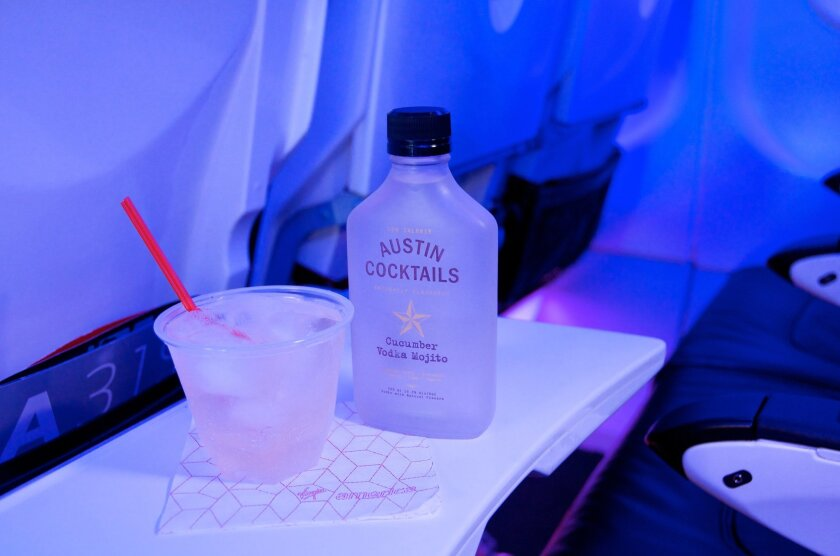 """This undated image provided by Virgin America airlines on Feb. 3, 2015 shows a cucumber vodka mojito cocktail available on the company's flights. Anthony Caporale, writer and host of the Off-Broadway musical comedy, """"The Imbible: A Spirited History of Drinking."""" expects drinks options in the sky to"""