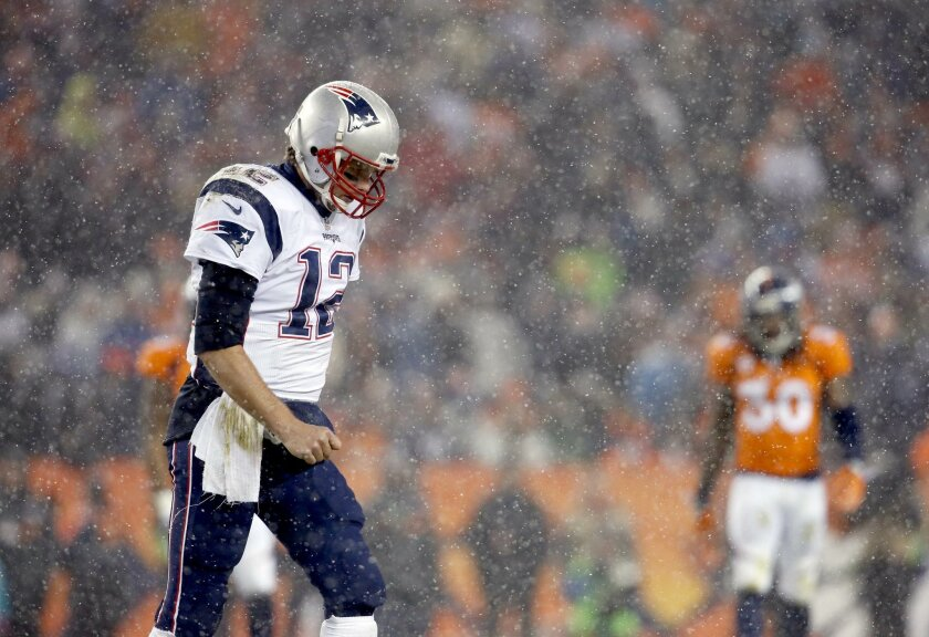 FILE - In this Nov. 29, 2015, file photo, New England Patriots quarterback Tom Brady (12) walks to the sidelines during the second half of an NFL football game against the Denver Broncos, in Denver. New England and Denver will play in the AFC Championship game on Sunday, Jan. 24, 2016, in Denver (AP Photo/Joe Mahoney, File)