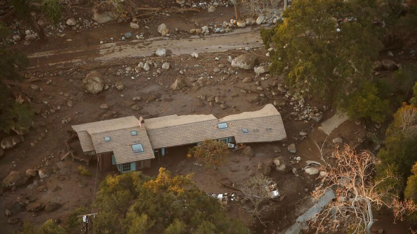 MONTECITO, CA – JANUARY 10, 2018: A home in the Romero Canyon area is surrounded by mud and debri