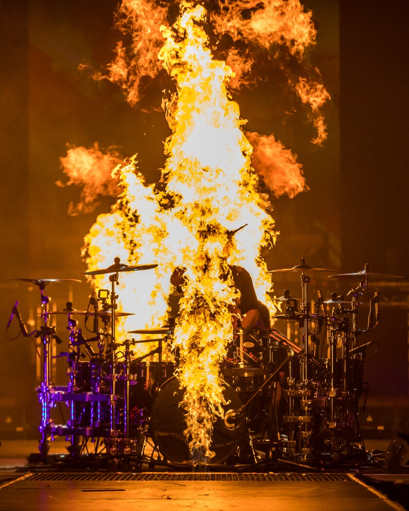 The Chainsmokers' drummer Matt McGuire performs in a pit of fire.