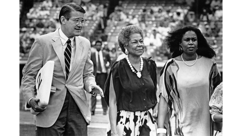 April 11, 1987: Dodgers President Peter O'Malley accompanies Jackie Robinson's wife and daughter, Ra