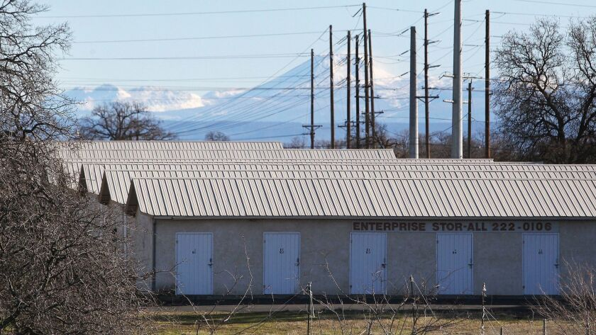 FILE - In this Dec. 15, 2015, file photo, a commercial storage unit facility is shown where two chil