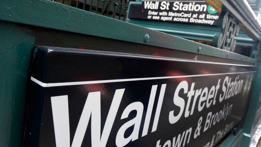 FILE- This Oct. 2, 2014, file photo shows the Wall Street subway stop on Broadway in New York's Fina
