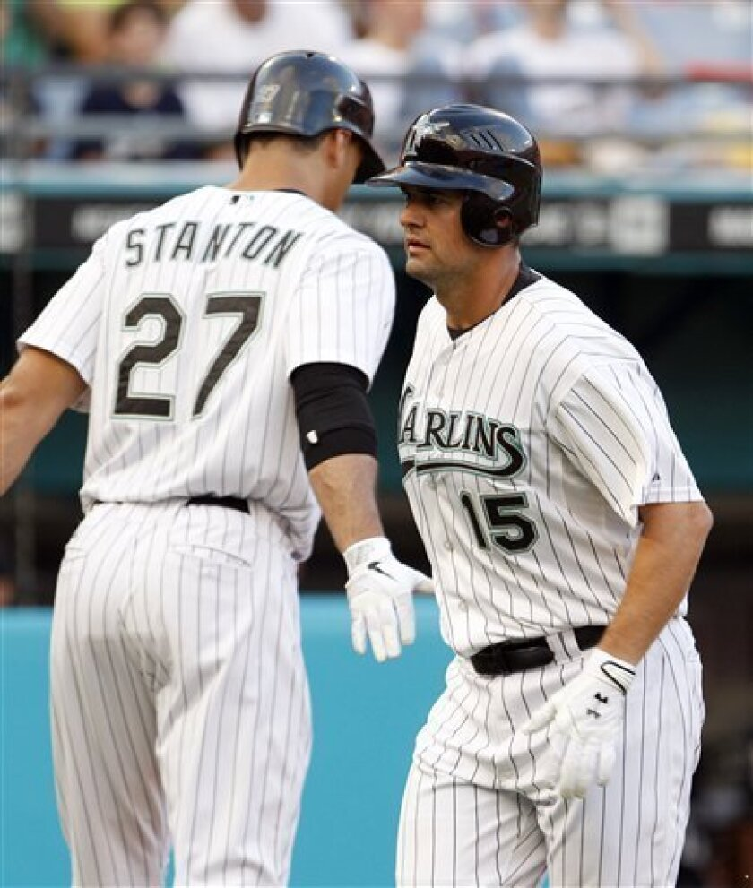 Florida Marlins' Gaby Sanchez (15) is greeted by teammate Mike Stanton (27) after hitting a solo home run against the Milwaukee Brewers in the second inning of a baseball game in Miami, Friday, June 3,  2011. The Brewers won 6-5. (AP Photo/Alan Diaz)