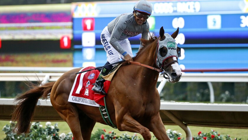 Jockey Victor Espinoza is all smiles after guiding California Chrome to victory in the $1-million Pacific Classic at Del Mar on Aug. 20.
