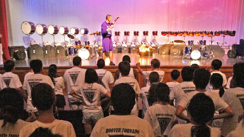 Hoover High School music instructor Martin Rhees, here shown in front of the school's marching band in 2013 when the group received new equipment, can now replace the drum heads on his school's marching percussion instruments thanks to a Glendale Educational Foundation grant.