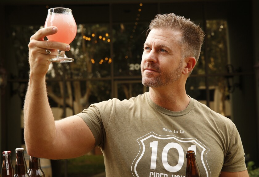 Mark McTavish, owner of 101 Cider, pours Cactus Red Cider, infused with local nopal cactus; and Thai basil.