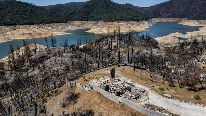 A home destroyed in the 2020 North Complex Fire sits above Lake Oroville on Sunday, May 23, 2021, in Oroville, Calif.