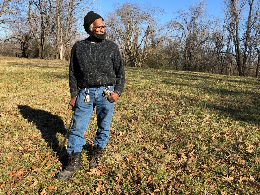 Clyde Robinson, 80, speaks with a reporter while standing on his acre-sized parcel of land on Thursday, Jan. 28, 2021, in Memphis, Tenn. Robinson is fighting an effort by two companies seeking a piece of his land to build part of an oil pipeline that would run through the Memphis area into north Mississippi. The Byhalia Connection would link two larger U.S. oil pipelines. (AP Photo/Adrian Sainz)
