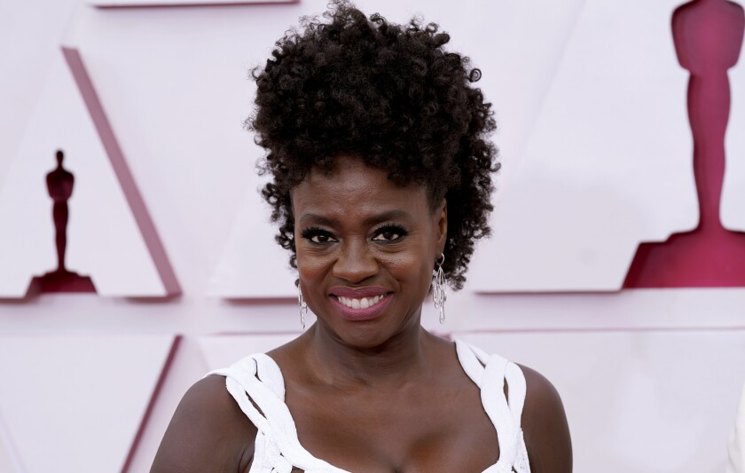 """FILE - In this April 25, 2021 file photo, Viola Davis arrives at the Oscars at Union Station in Los Angeles. Davis is working on a memoir her publisher calls deeply personal and brutally honest. HarperOne will release Davis' """"Finding Me"""" on April 19, 2022. Davis will trace her rise from growing up in poverty and family violence in Rhode Island to becoming one of the world's most acclaimed actors. (AP Photo/Chris Pizzello, Pool, File)"""