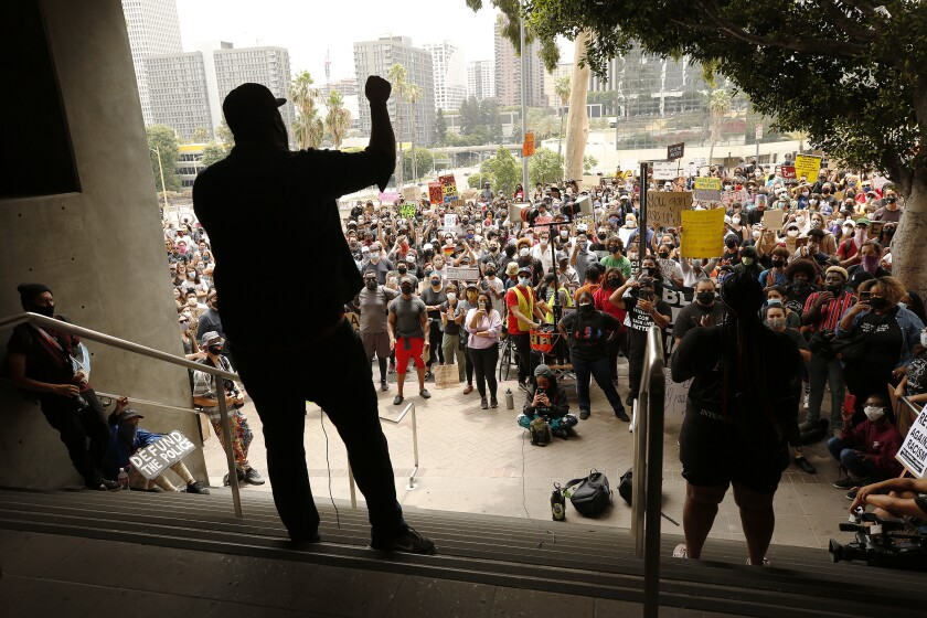 Demonstrators gather outside Los Angeles Unified School District headquarters.