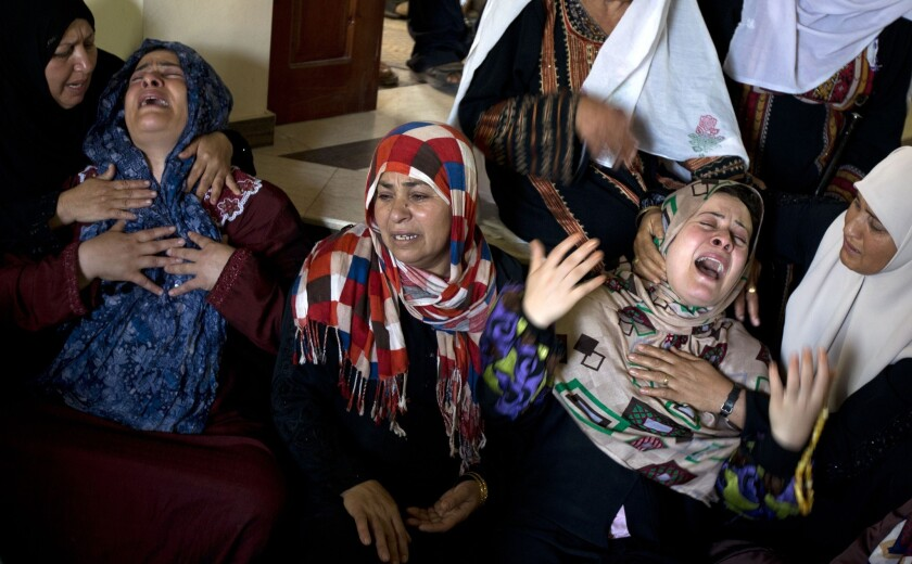 Palestinian women grieve following the deaths of several people in an Israeli air strike on a home in the north of the Gaza Strip early Wednesday.