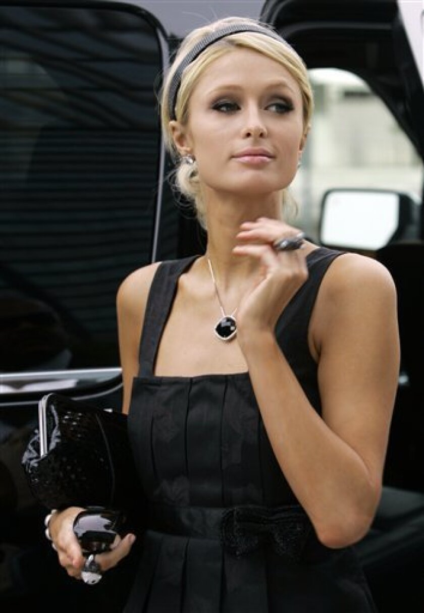 """Paris Hilton arrives at federal court in Miami, Friday, July 10, 2009. Hilton is accused in a federal lawsuit of failing to adequately promote her 2006 movie """"Pledge This!."""" (AP Photo/Alan Diaz)"""