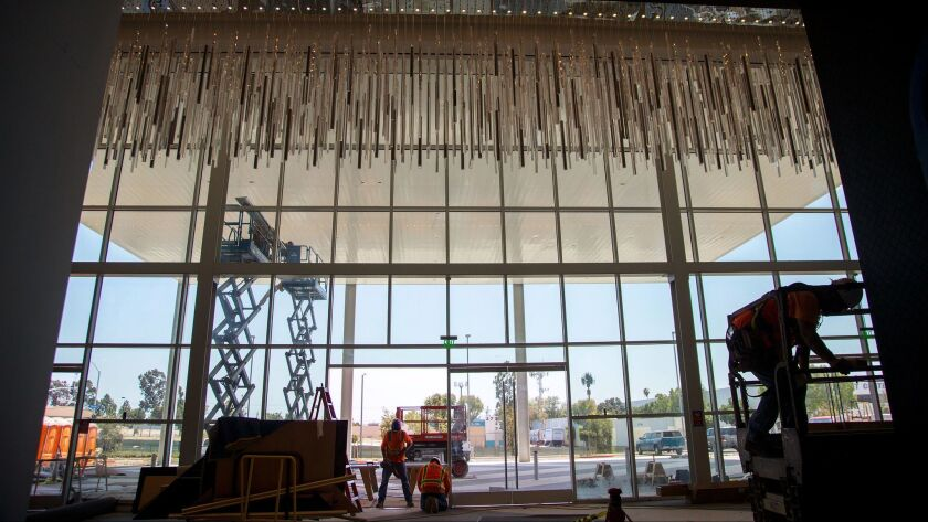 Construction workers put the finishing touches on the new Hollywood Park Casino off Century Boulevard in Inglewood, California on July 5, 2016.